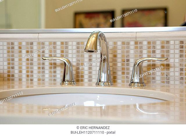 Faucet with spigot at bathroom sink; Azusa; California; USA