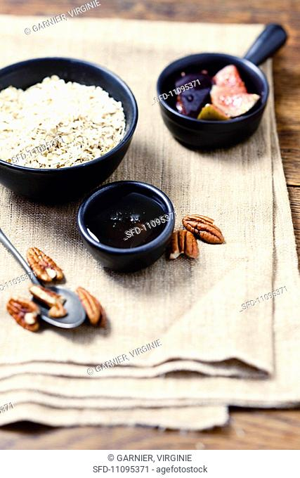 Ingredients for porridge with figs, honey and pecan nuts