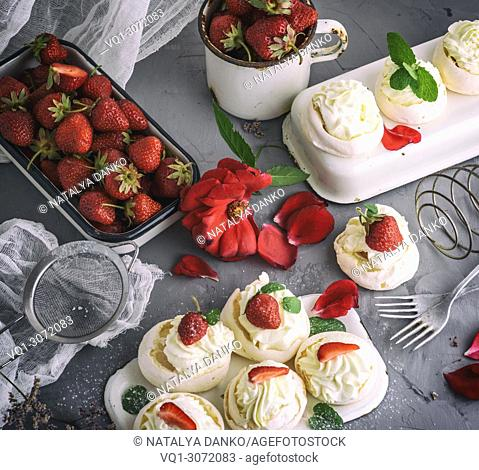 baked meringue with cream and fresh strawberries, top view