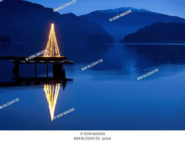 Illuminated Christmas tree on wooden pier