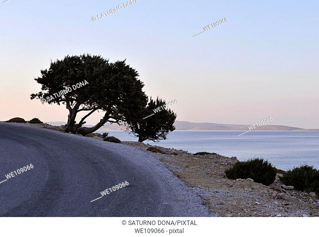 Winding road at dusk in Lipsi island, Greece