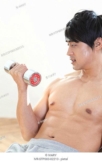 Asian Man Holding Weight Lift