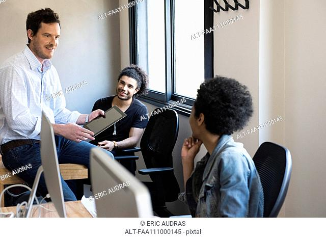 Colleagues collaborating in office