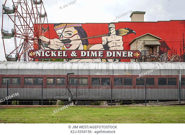 Fort Smith, Arkansas - The Nickel & Dime Diner, below wall art and a Ferris wheel. The painting is 'War Paint' by a British artist known as D*FACE