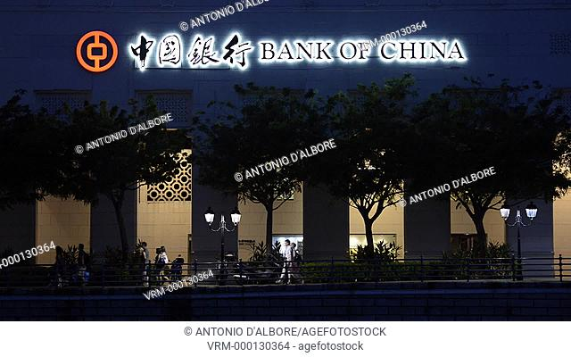 People walking past a Bank of China branch. Singapore