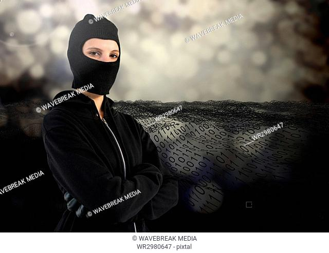 Woman hacker with hood and arms crossed standing on in front of digital background