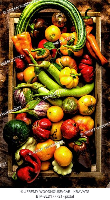Crate of peppers, tomatoes and vegetables