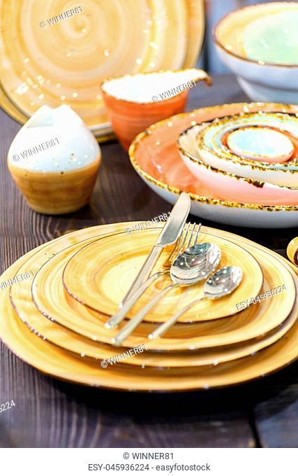 kitchen utensils plates spoons knife