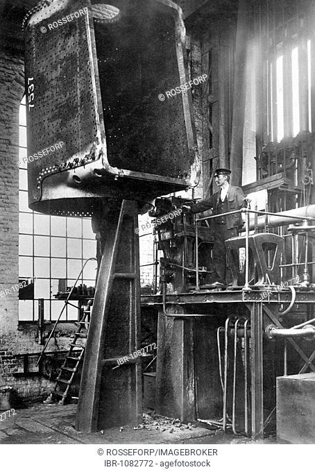 Steam locomotive construction, boiler being riveted with a hydraulic press, Borsigwerke Berlin-Tegel Factory, Germany, historic photograph, around 1910