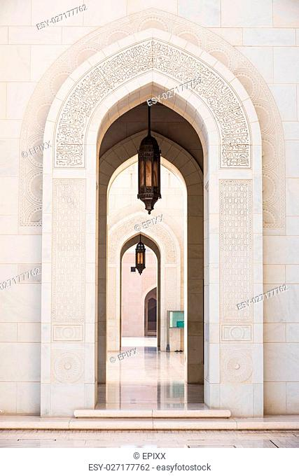 Gates surrounded by scriptures from the Quran at Sultan Qaboos Grand Mosque in Muscat, the main mosque of The Sultanate of Oman