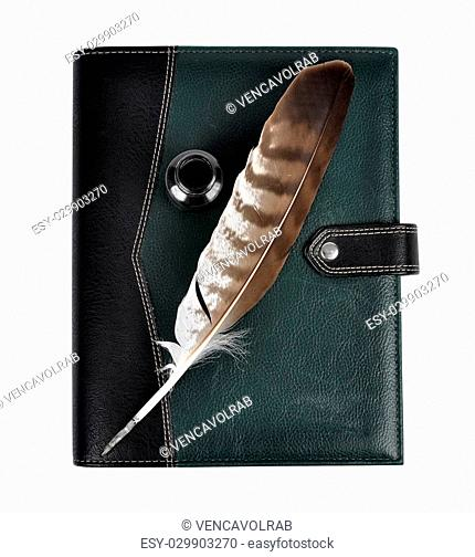 Feather with ink bottle and notebook