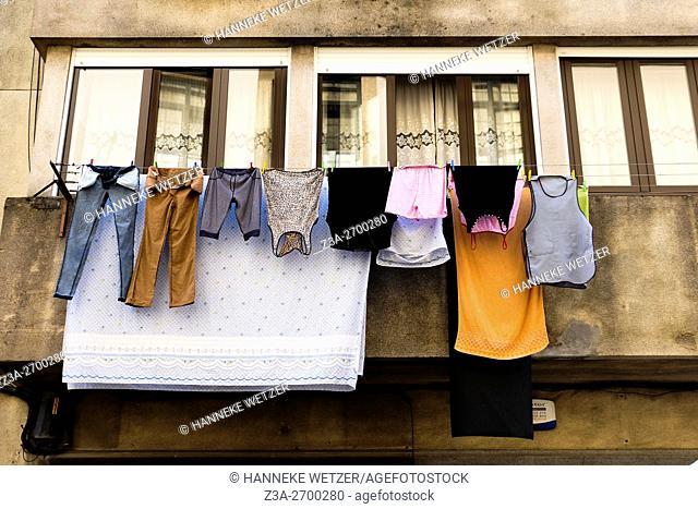 Laundry hanging from buildings in Vila Nova de Gaia, Portugal