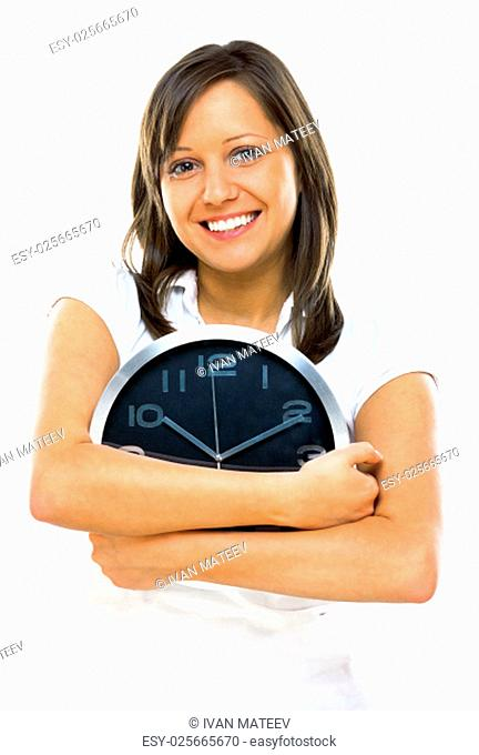 Young woman posing at camera with clock in her hands