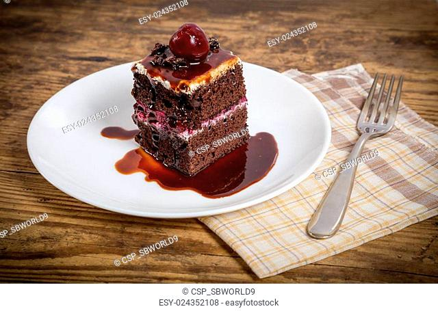 Dark chocolate cake with cherry
