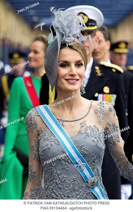 Crown Prince Felipe and Crown Princess Letizia of Spain leave the Nieuwe Kerk after the investiture ceremony of King Willem-Alexander in Amsterdam