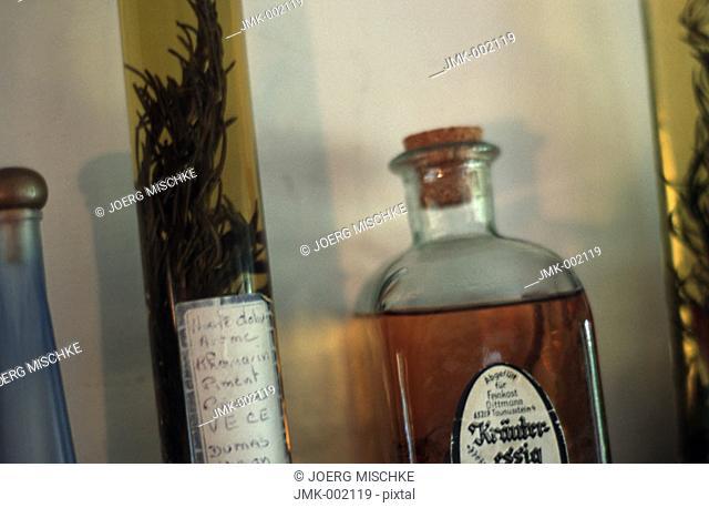 Bottles, oil, vinegar, on a kitchen board