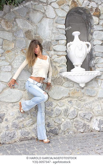 Beautiful woman close to ceramic jars posing for the camera in different sensual positions in Yalta, Crimea