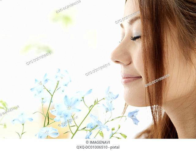Woman enjoying smelling flower
