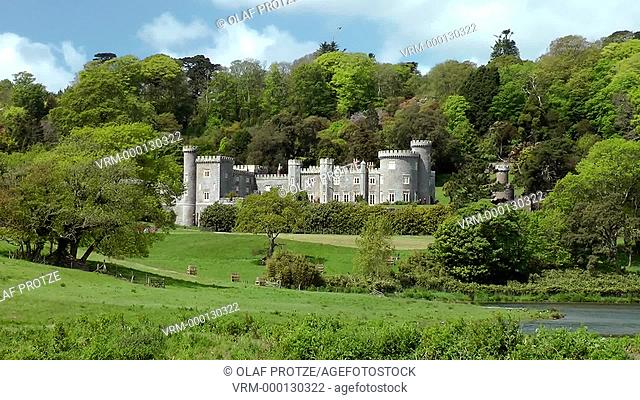 View at Caerhays Castle or Carhayes Castle a semi-castellated manor house south of St Michael, Caerhays, Cornwall, England, UK