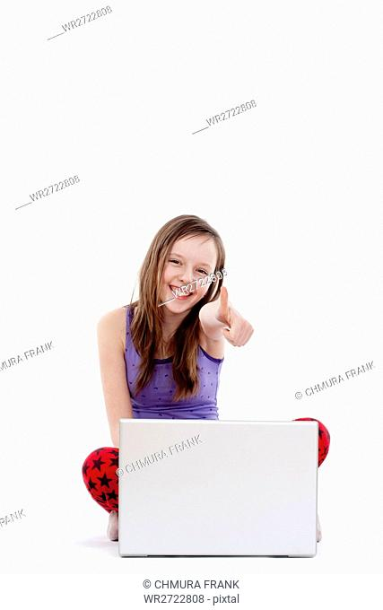 happy girl with laptop showing thumbs up - isolated on white
