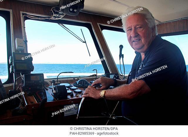 Captain Tom Paladino steering the 'American Princess' during a whale watching tour near New York, US, 4 August 2016. Since recently