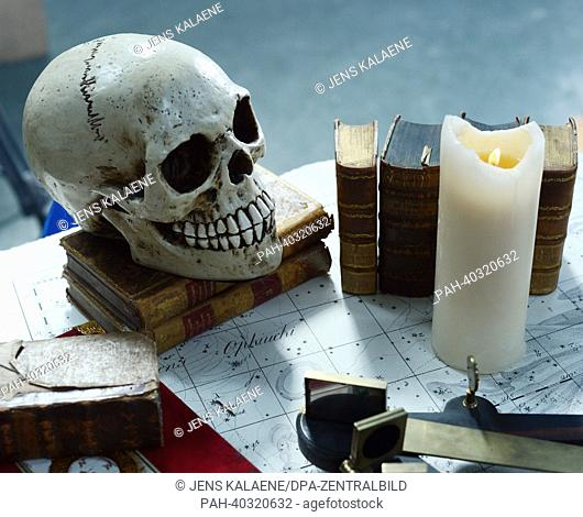 dpa-Exclusive - Film props books, a candle and a scull are on display on the film set during the shooting of the music video 'Heyahoo!' of the music project...
