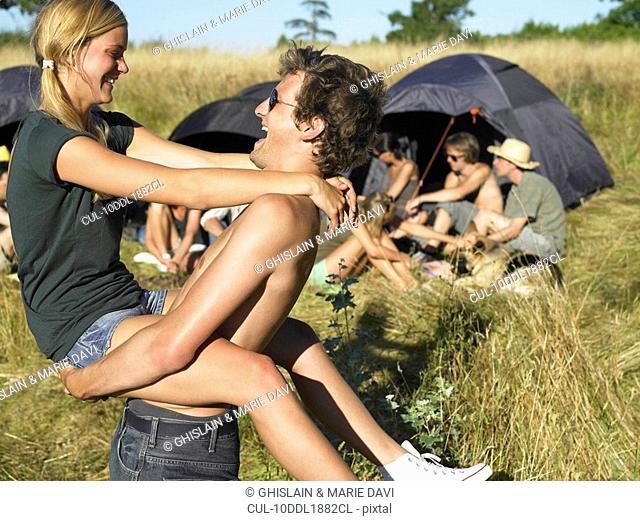 Couple dancing, backpacking tents
