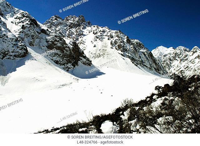 Kyrgyzstan, Central Asia: Mountains and valley with snow near the capital Bishkek during early spring in april with blue sky