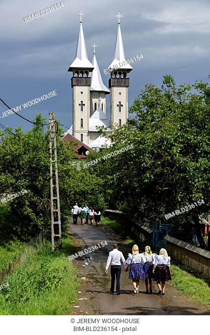 People walking on road to church, Breb, Maramures, Romania
