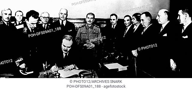 Signing of the Hitler-Stalin Pact in Moscow. Molotov ratifying the document. Behind him, von Ribbentrop and Stalin 1939 USSR, Second World War war