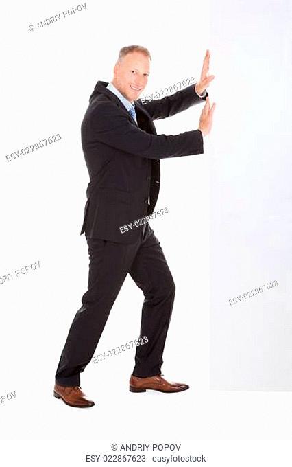 Confident Businessman Showing Billboard