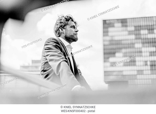 Businessman standing on bridge
