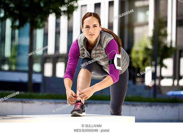 Athletic brunette woman outdoors