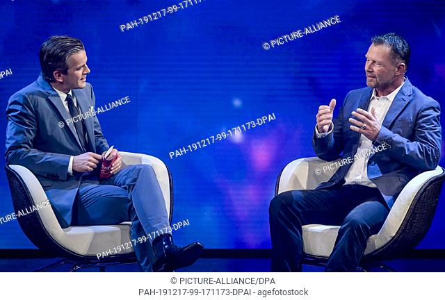 16 December 2019, Hamburg: The diver Rainer Schimpf (r), who was almost swallowed by a whale, is interviewed on stage by presenter Markus Lanz during the ZDF...