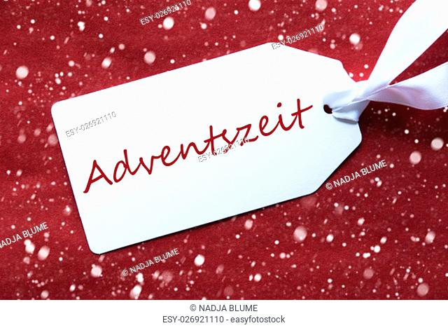 One White Label On A Red Textured Background. Tag With Ribbon And Snowflakes. German Text Adventszeit Means Advent Season