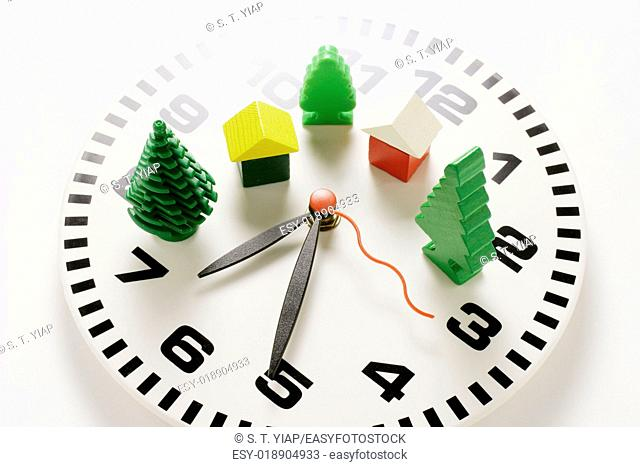 Miniature houses and trees on clock