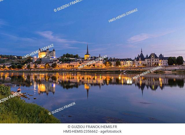 France, Maine et Loire, Loire valley listed as World Heritage by UNESCO, Saumur, the castle, Saint-Pierre church and the town hall are reflected in the Loire...