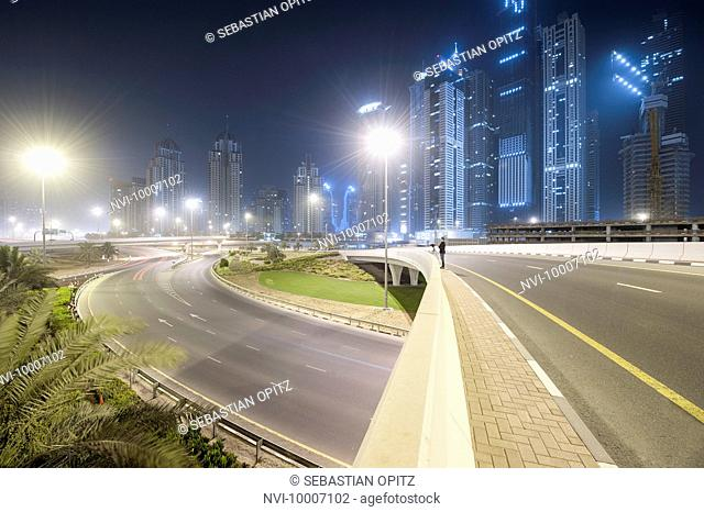 Interchange on Sheikh Zayed Road, skyscrapers and nocturnal haze in Marina, New Dubai, UAE