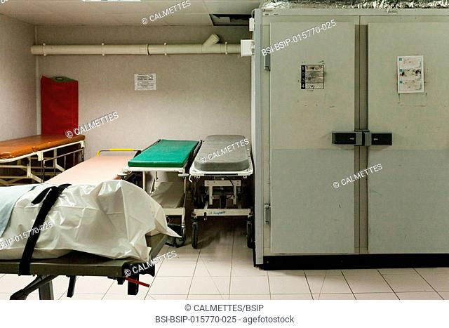 A dead body (corpse) is just arrived in the mortuary chamber in an hospital, PACA, FRANCE