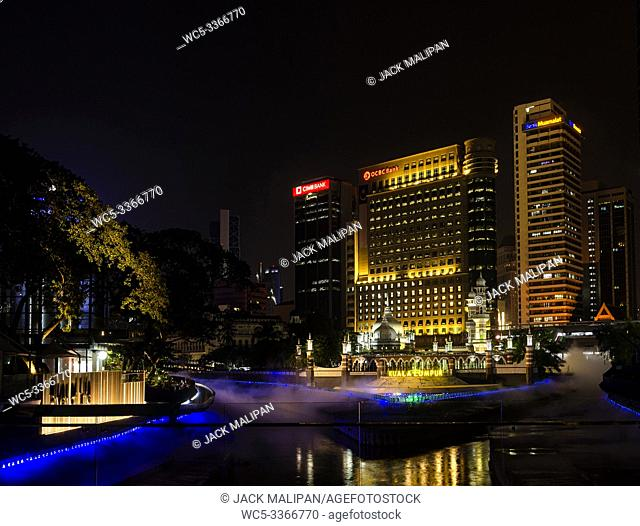 River of Life riverfront area with Jamek Mosque landmark in central Kuala Lumpur city Malaysia at night