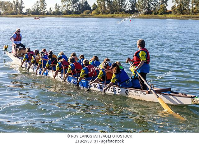 Dragon Boat crew paddling to start a race at the 2017 Steveston Dragon Boat Festival near Vancouver, Canada
