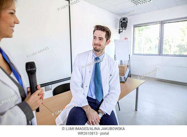 Female doctor and colleague giving presentation in training class