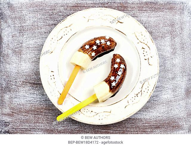 Bananas with chocolate. Party dessert