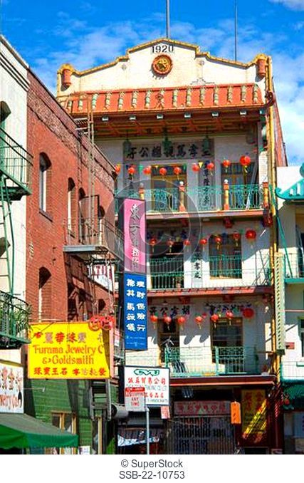Banners with Chinese lanterns hanging outside a building, Chinatown, San Francisco, California, USA