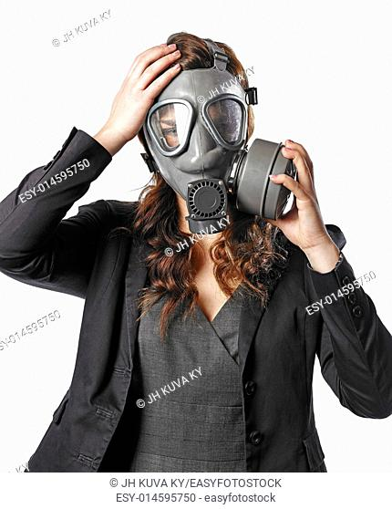 Business looking young adult woman put on a personal gas mask on her face - white background