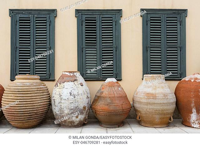 Massive traditional ceramic vessels in front of the building of Psaropoulos Museum of Traditional Pottery in Athens.