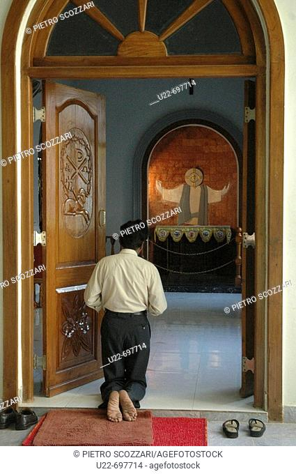 Santa Cruz, near Panjim Goa, India: a man praying in the local church