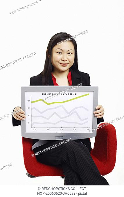 Portrait of a businesswoman sitting on a chair and holding a progress report