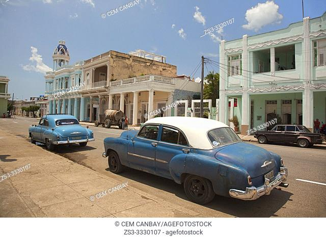 Old American cars parked at Jose Marti Park in front of the Ferrer Palace in the city center, Cienfuegos, Cuba, Central America