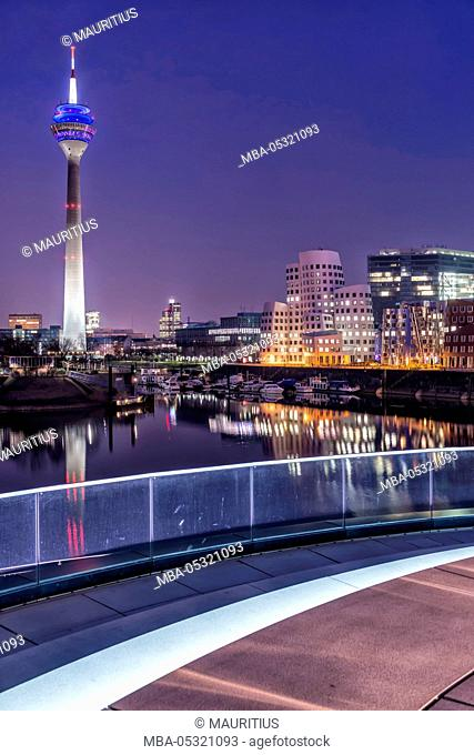 Düsseldorf, North Rhine-Westphalia, Germany, media harbour with television tower and Gehry houses at dusk